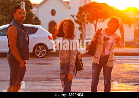 stylish young guy and girls in jeans, travel and fashion - Stock Photo