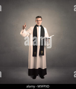 young priest is giving his blessing - Stock Photo