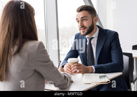 Business Couple in Cafe - Stock Photo