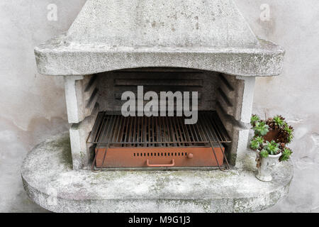 Smoky antique brick oven outdoor with ashes inside. Old garden heater. grill usable for BBQ. patio Vienna, Austria - Stock Photo
