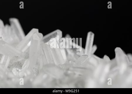 Pure Quartz Crystal cluster on black background - Stock Photo