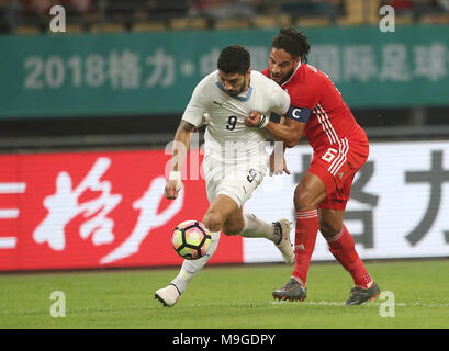 Nanning, China's Guangxi Zhuang Autonomous Region. 26th Mar, 2018. Luis Suarez (L) of Uruguay vies with Ashley Williams of Wales during the final match between Wales and Uruguay at the 2018 China Cup International Football Championship in Nanning, capital of south China's Guangxi Zhuang Autonomous Region, March 26, 2018. Credit: Cao Can/Xinhua/Alamy Live News - Stock Photo