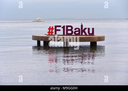 Baku, Azerbaijan - December 22, 2017: Formula 1 sign over water on cloudy December early evening at Bay of Baku in Baku, Azerbaijan. - Stock Photo
