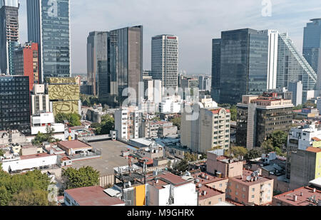 The distant skyscrapers of the Finance District in Mexico City, Mexico tower over the neighboring Zona Rosa neighborhood in the foreground. - Stock Photo