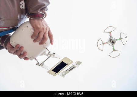 Pilot flying drone with FPV mount empty on remote controller. Approaching maneuver - Stock Photo
