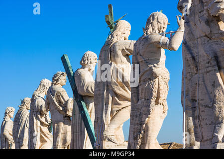 Jesus Christ statue with his 12 disciples at the top of St Peter's Cathedral, Vatican city, Rome, Lazio, Italy. - Stock Photo