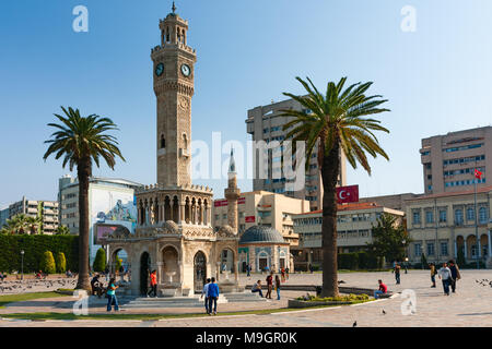 IZMIR, TURKEY - OCTOBER 04, 2014: Konak Square, Clock Tower, symbol of Izmir, built in 1901 and Yali Mosque in the background - Stock Photo