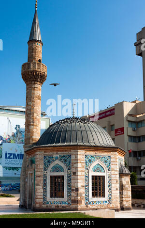 IZMIR, TURKEY - OCTOBER 04, 2014: Yali Mosque called Konak Mosque, famous octagonal shaped landmark at the Konak Square, built in 1755. Dome and minar - Stock Photo
