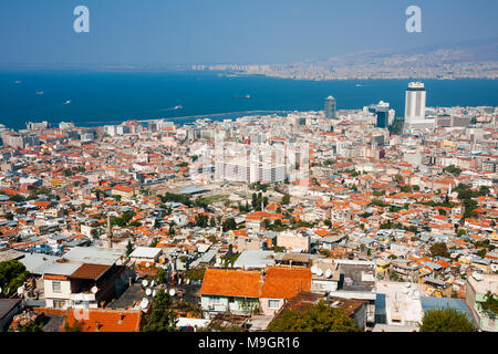 IZMIR, TURKEY - OCTOBER 04, 2014:  Birds eye view with the  Agora, ancient market place in center. Residential buildings, Aegean Sea and ships - Stock Photo
