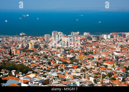 IZMIR, TURKEY - OCTOBER 04, 2014:  Birds eye view in Konak Pier direction of Izmir. Residential buildings, Aegean Sea and ships - Stock Photo