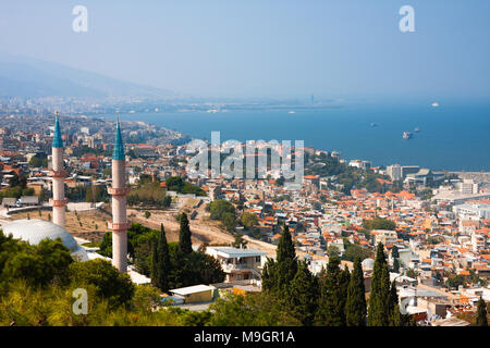 IZMIR, TURKEY - OCTOBER 04, 2014:  Birds eye view of the south side of Izmir and Kadifekale Camii - mosque. Residential area buildings, Aegean Sea and - Stock Photo