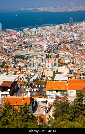 IZMIR, TURKEY - OCTOBER 04, 2014:  Birds eye view with the  Agora, ancient market place in center and ald residential buildings in front - Stock Photo