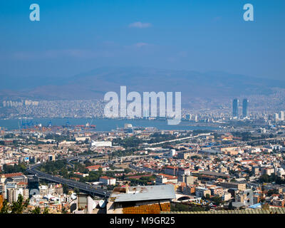 IZMIR, TURKEY - OCTOBER 04, 2014:  Birds eye view of the Izmir  and Izmir Port, at the Aegean Sea. Residential area buildings and streets, distant mou - Stock Photo