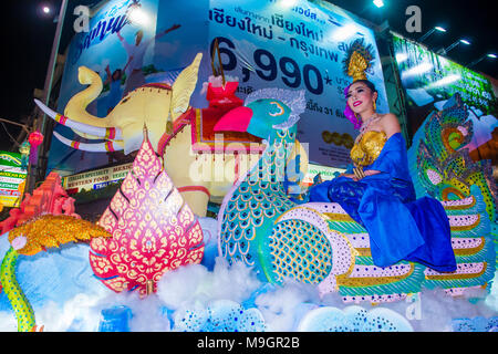 Participants in a parade during Yee Peng festival in Chiang Mai , Thailand - Stock Photo