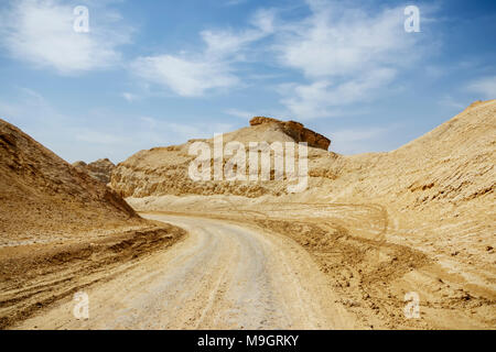 A country road between the old white mountains - Stock Photo