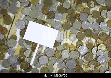 Accumulated coins stacked in glass jars - Stock Photo