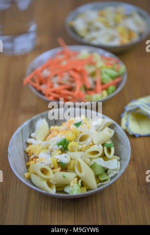 bowl of fresh summer pasta salad on wood - Stock Photo