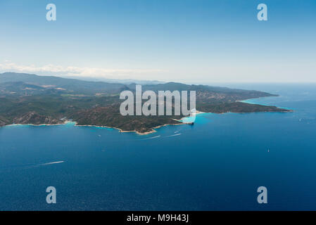 Aerial image of turquoise blue waters at the Corsican coastline West of Saint-Florent showing Punta Cavallata and Plage du Lotu, France - Stock Photo
