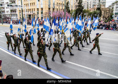 Athens, Greece. 25th Mar, 2018. A military detachment with Greek flags is marching during the parade. A military parade takes place due to Independence Day in Greece. 25th March is the commemoration of the revolution of Greeks against Ottoman occupation in 25th March 1821. Credit: Kostas Pikoulas/Pacific Press/Alamy Live News - Stock Photo