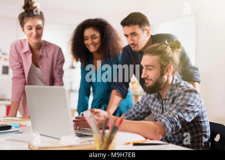 Young multiethnic creative team sharing ideas on a project  - Stock Photo