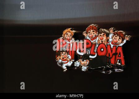 A cartoon fridge magnet showing people and bulls during the event of San Fermín festival. - Stock Photo