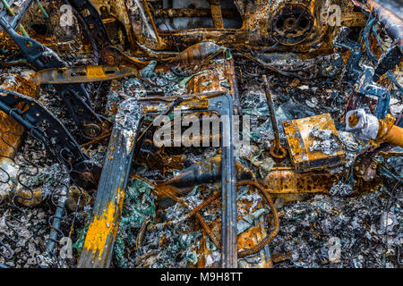 Burned out abandoned car, County Kerry Ireland - Stock Photo