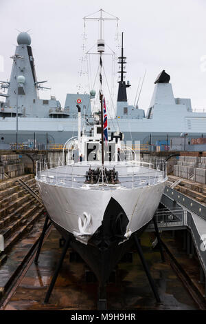 HMS M.33 / M33; one of three remaining British warships from World War I HMS Diamond (modern Type 45 Destroyer) is behind. Portsmouth Historic Dockyard UK - Stock Photo