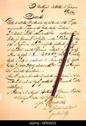 Old manuscript with nib isolated on white - Stock Photo