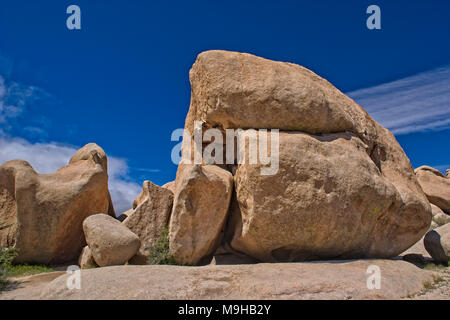 Huge bold Monzogranite rock formations in Joshua tree national Park in Southern California's Mohave Desert - Stock Photo