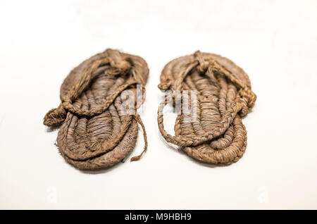 Madrid, Spain - November 11, 2017: Prehistoric Esparto sandals at National Archeological Museum of Madrid. Middle Neolithic - Stock Photo