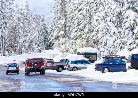 43,160.09728 winter snow-covered road, trees & driving & parked vehicle - Stock Photo