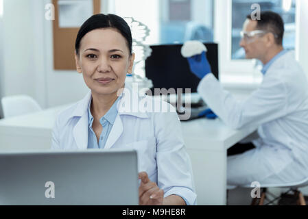 Inspired researchers working in the lab - Stock Photo