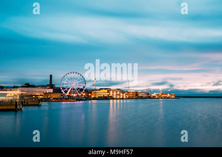 Helsinki, Finland. View Of Embankment With Ferris Wheel In Evening Night Illuminations. - Stock Photo