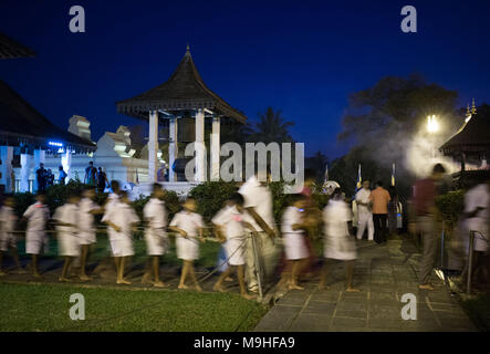 School students walking in a queue at Temple of the Tooth, Kandy, Sri Lanka, Asia. - Stock Photo