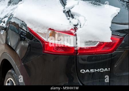 Nissan Qashqai covered in snow during Storm Emma, parked in Coventry, West Midlands, UK. - Stock Photo
