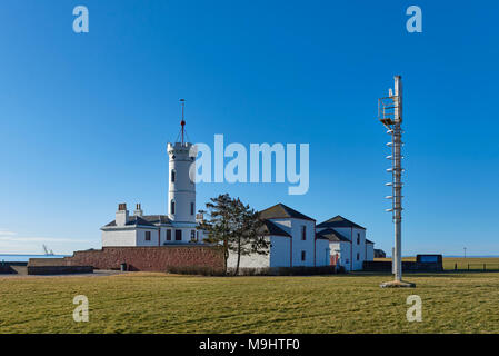 The Arbroath Signal Tower, which is now a museum,  stands on the Coastline just up from Arbroath harbour, and in sight of the Bell Rock Lighthouse. - Stock Photo