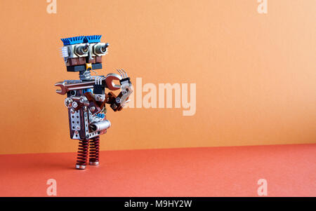 Robot engineer repaier with hand wrench. 4th industrial revolution automation concept. Creative design robotic serviceman on brown wall red floor background. Copy text - Stock Photo