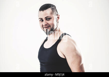 portrait of charismatic trainer on bodybuilding on a light background - Stock Photo