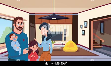 Young Family Parents With Two Kids In Modern Living Room At Home - Stock Photo