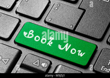 Written word Book Now on blue keyboard button - Stock Photo