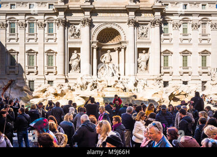 Crowds of tourists at Trevi Fountain (Fontana di Trevi) in Rome, Lazio, Italy. - Stock Photo