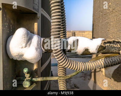 Air Conditioner With Frozen Ice And Icicles Cooling Cold