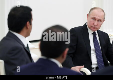 Moscow, Russia. 26th Mar, 2018. MOSCOW, RUSSIA - MARCH 26, 2018: Russia's President Vladimir Putin (R) during a meeting with Emir Tamim bin Hamad Al Thani of Qatar at the Moscow Kremlin. Mikhail Klimentyev/Russian Presidential Press and Information Office/TASS Credit: ITAR-TASS News Agency/Alamy Live News - Stock Photo