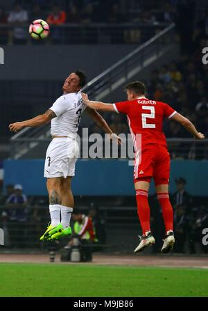 Uruguay's Cristian Rodriguez (L) and Wales' Chris Gunter (R) in action during a China Cup final match between the soccer national teams of Wales and Uruguay in Nanning, China, 26 March 2018. EFE/ Jun Lee PROHIBIDO SU USO EN CHINA - Stock Photo