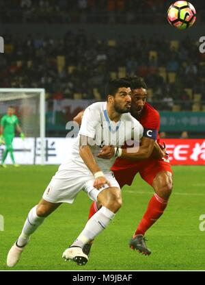 Nanning, China. 26th Mar, 2018. Uruguay's Luis Suarez (L) and Wales' Ashley Williams (R) vie for a ball during a China Cup final match between the soccer national teams of Wales and Uruguay in Nanning, China, 26 March 2018. Credit: Jun Lee PROHIBIDO SU USO EN CHINA/EFE/Alamy Live News - Stock Photo