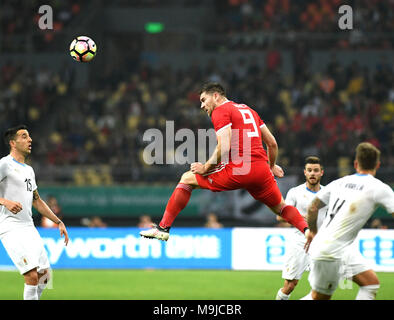 Nanning, China's Guangxi Zhuang Autonomous Region. 26th Mar, 2018. Sam Vokes (2nd L) of Wales heads for the ball during the final match between Wales and Uruguay at the 2018 China Cup International Football Championship in Nanning, capital of south China's Guangxi Zhuang Autonomous Region, March 26, 2018. Uruguay won the final by 1-0 against Wales and claimed the title of the event. Credit: Zhou Hua/Xinhua/Alamy Live News - Stock Photo
