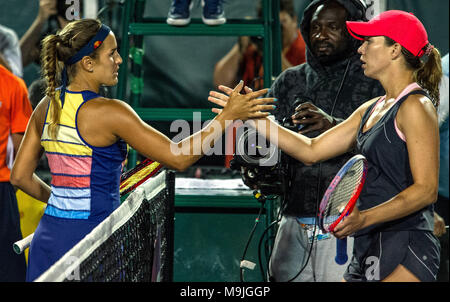 Miami, USA. 26th Mar, 2018. US. Danielle Collins (R) shakes hands with Puertorrican Monica Puig, after the fourth round match at the Miami Open tennis tournament on Key Biscayne, Miami, Florida, USA, 26 March 2018. Credit: Giorgio Viera/EFE/Alamy Live News - Stock Photo