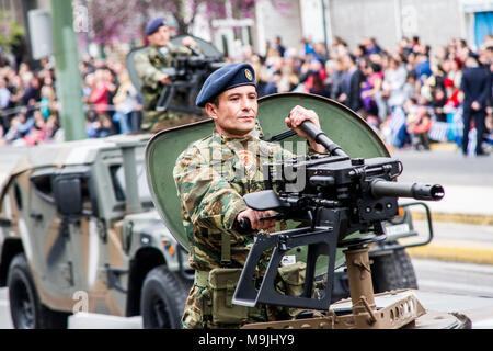 A soldier is seen on an armored vehicle holding a machine gun during the parade. A military parade takes place due to Independence Day in Greece. 25th March is the commemoration of the revolution of Greeks against Ottoman occupation in 25th March 1821.   Photo: Cronos/Kostas Pikoulas - Stock Photo