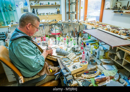 Bladesmith or knifemaker working in his shop, Iceland - Stock Photo