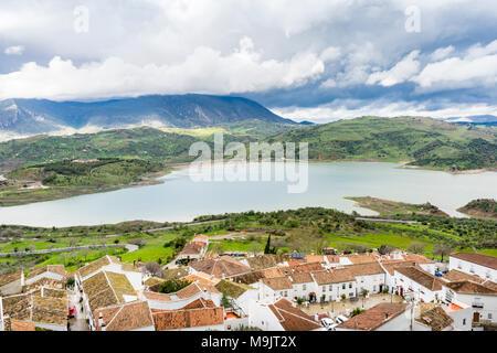 Scenic views over the village of Zahara de la Sierra to the Zahara-El Gastor Reservoir (Embalse de Zahara), an artificial lake in Andalusia, Spain - Stock Photo